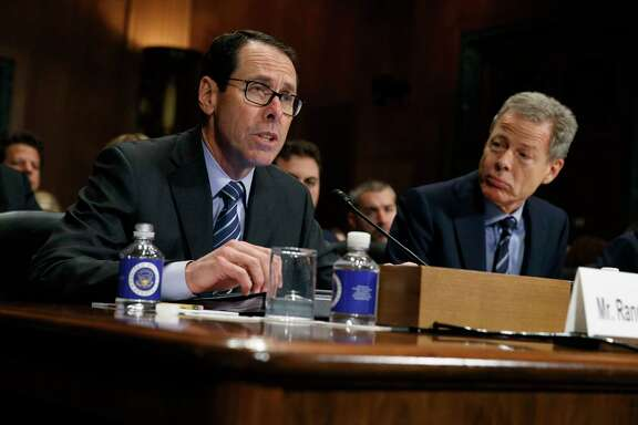 AT&T Chairman and CEO Randall Stephenson, left, testifies last year before a Senate Judiciary subcommittee hearing on the proposed merger between AT&T and Time Warner, as Time Warner Chairman and CEO Jeffrey Bewkes listens.