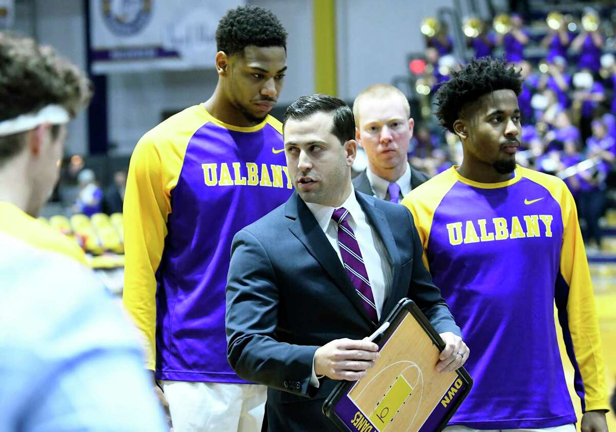 UAlbany's acting head coach Jon Iati, instructs his players against Oneonta during the first half of an NCAA men's college basketball game on Monday, Nov. 20, 2017, in Albany, N.Y. (Hans Pennink / Special to the Times Union) ORG XMIT: HP102