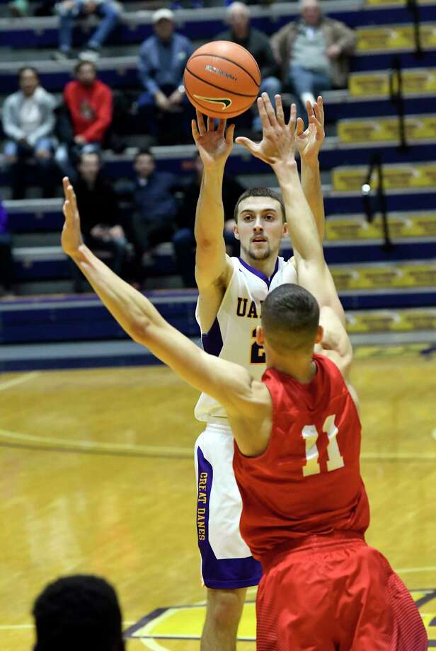 UAlbany's Joe Cremo (24) puts up a shot over Oneonta's Dwayne Freeman (11) during the first half of an NCAA men's college basketball game on Monday, Nov. 20, 2017, in Albany, N.Y. (Hans Pennink / Special to the Times Union) ORG XMIT: HP106 Photo: Hans Pennink / 20042182A
