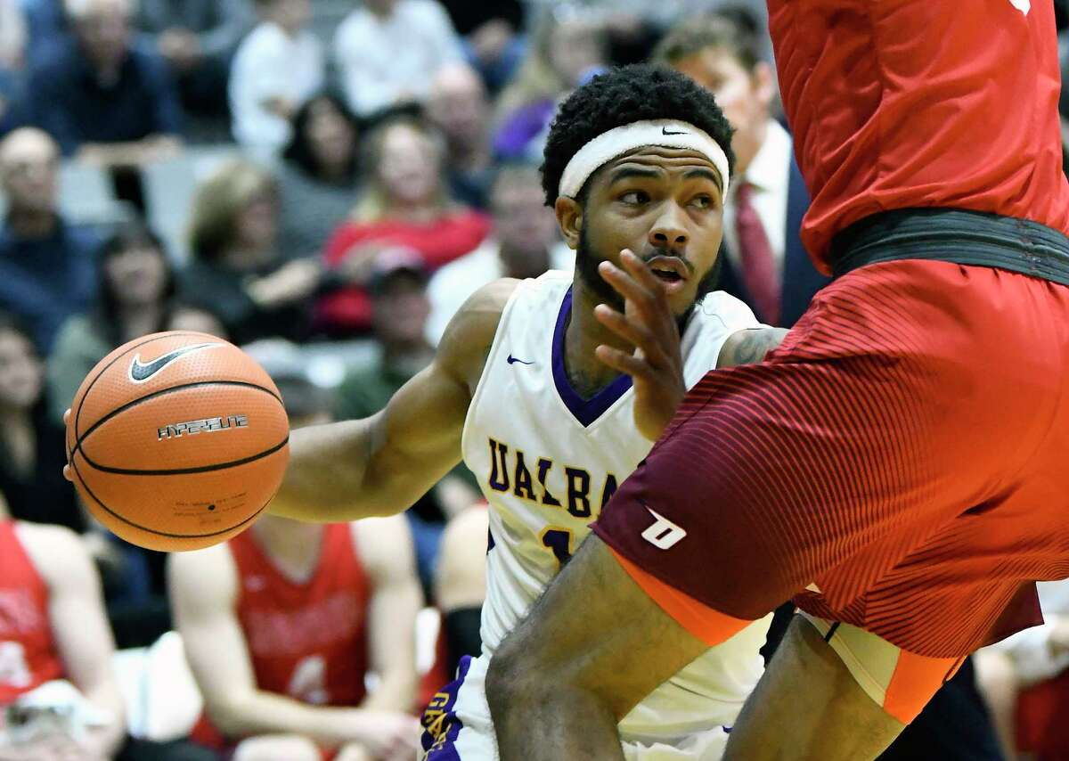 UAlbany's David Nichols (13) moves the ball against Oneonta during the first half of an NCAA men's college basketball game on Monday, Nov. 20, 2017, in Albany, N.Y. (Hans Pennink / Special to the Times Union) ORG XMIT: HP108