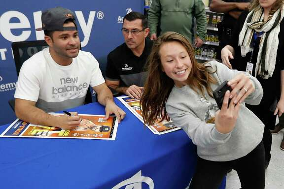 Sarah Saenz, 14, was the last person in line allowed to get Astros MVP Jose Altuve's autograph at the Academy store Monday in Katy.
