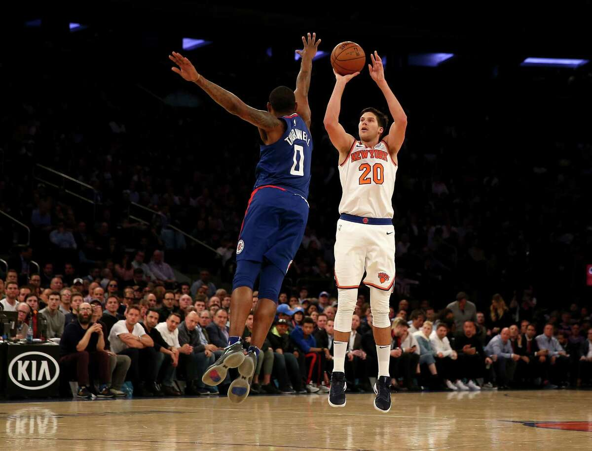 NEW YORK, NY - NOVEMBER 20: Doug McDermott #20 of the New York Knicks shoots a three point shot as Sindarius Thornwell #0 of the Los Angeles Clippers defends at Madison Square Garden on November 20, 2017 in New York City. NOTE TO USER: User expressly acknowledges and agrees that, by downloading and or using this Photograph, user is consenting to the terms and conditions of the Getty Images License Agreement (Photo by Elsa/Getty Images) ORG XMIT: 775026895