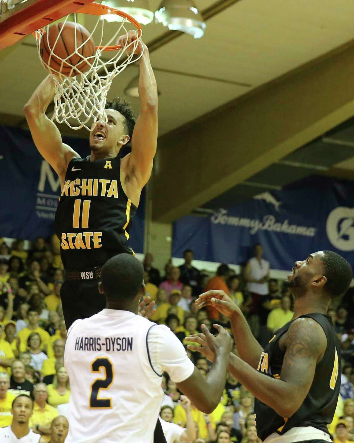 Wichita State guard Landry Shamet (11) dunks the ball during the second half of an NCAA college basketball game, Monday, Nov. 20, 2017, in Lahaina, Hawaii. (AP Photo/Marco Garcia) ORG XMIT: HIMG134