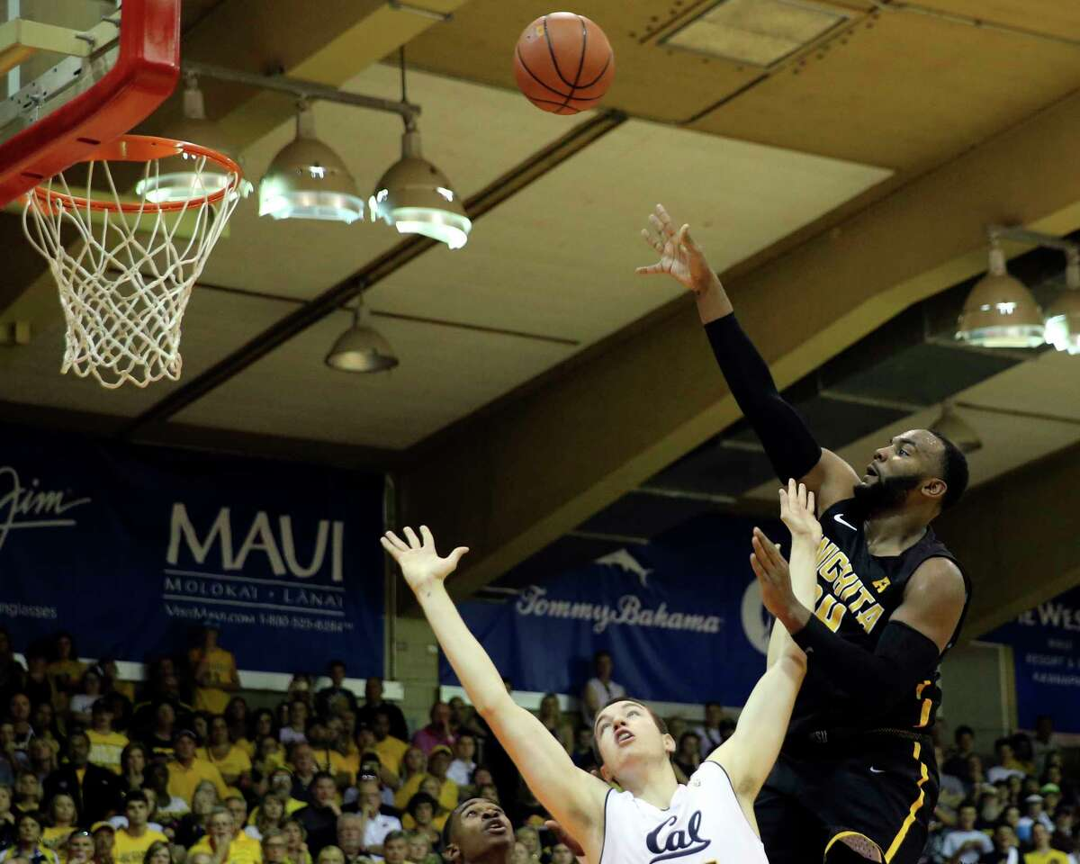 California forward Grant Anticevich, left, can't stop Wichita State center Shaquille Morris, right, during the second half of an NCAA college basketball game, Monday, Nov. 20, 2017, in Lahaina, Hawaii. (AP Photo/Marco Garcia) ORG XMIT: HIMG141