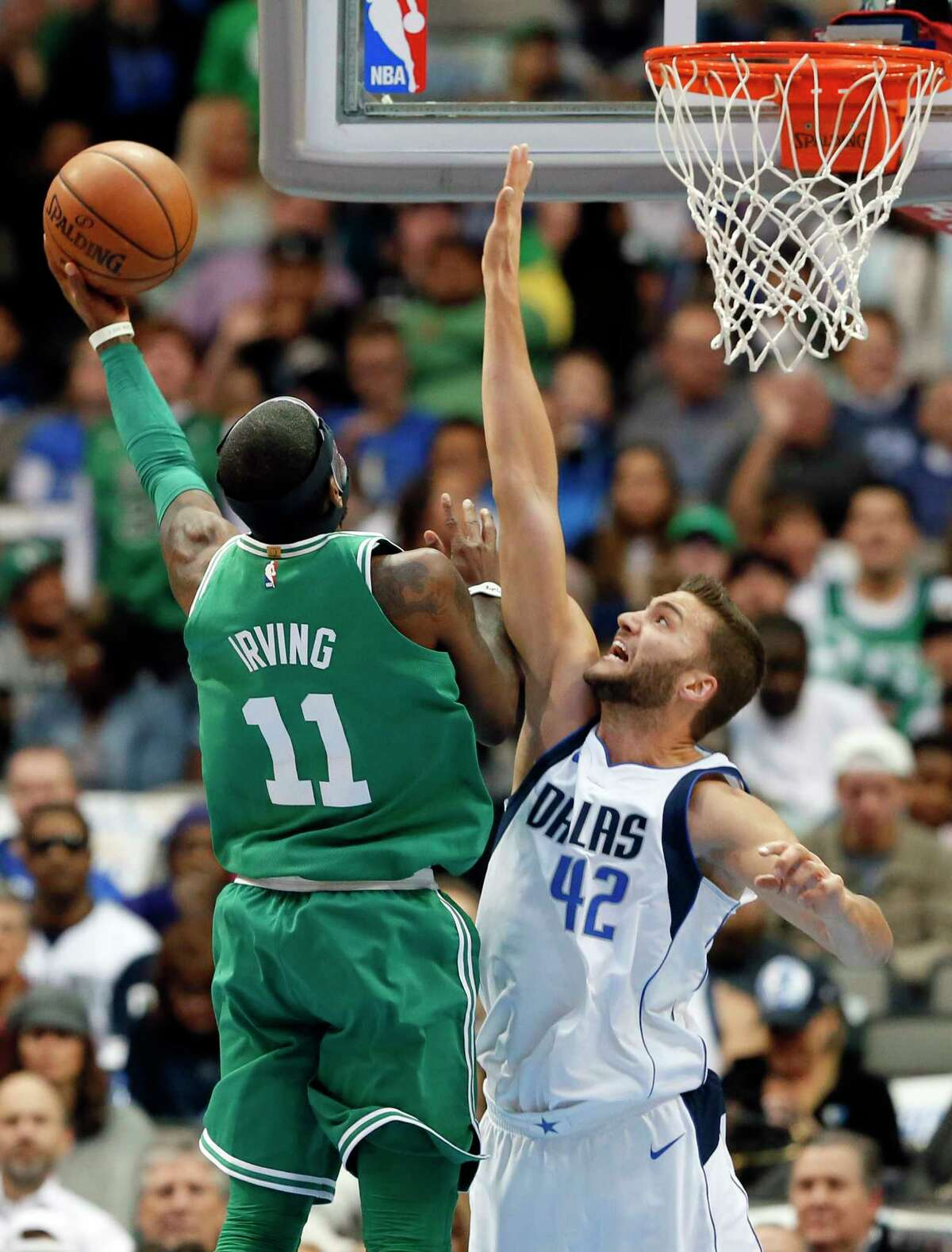 Boston Celtics' Kyrie Irving (11) goes up to shoot over Dallas Mavericks' Maximilian Kleber (42), of Germany, in the first half of an NBA basketball game, Monday, Nov. 20, 2017, in Dallas. (AP Photo/Tony Gutierrez) ORG XMIT: DNA107