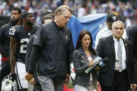 Oakland Raiders head coach Jack Del Rio walks off the field at halftime of an NFL football game against the New England Patriots, Sunday, Nov. 19, 2017, in Mexico City.