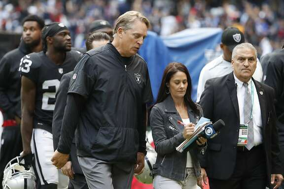 Oakland Raiders head coach Jack Del Rio walks off the field at halftime of an NFL football game against the New England Patriots, Sunday, Nov. 19, 2017, in Mexico City. (AP Photo/Eduardo Verdugo)