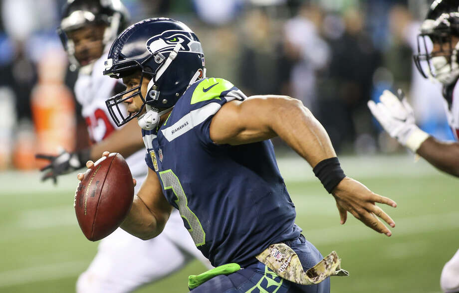 Seahawks quarterback Russell Wilson runs the ball for a first down in the second half against the Falcons at CenturyLink Field on Monday, Nov. 20, 2017. Photo: GRANT HINDSLEY, SEATTLEPI.COM / SEATTLEPI.COM