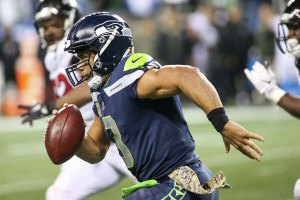 Seahawks quarterback Russell Wilson runs the ball for a first down in the second half against the Falcons at CenturyLink Field on Monday, Nov. 20, 2017.