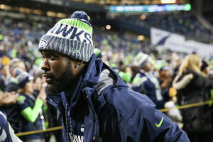 Seahawks safety Kam Chancellor walks off the field following the Seahawks 34-31 loss to the Atlanta Falcons at CenturyLink Field on Monday, Nov. 20, 2017. Chancellor didn't dress due to a neck injury.