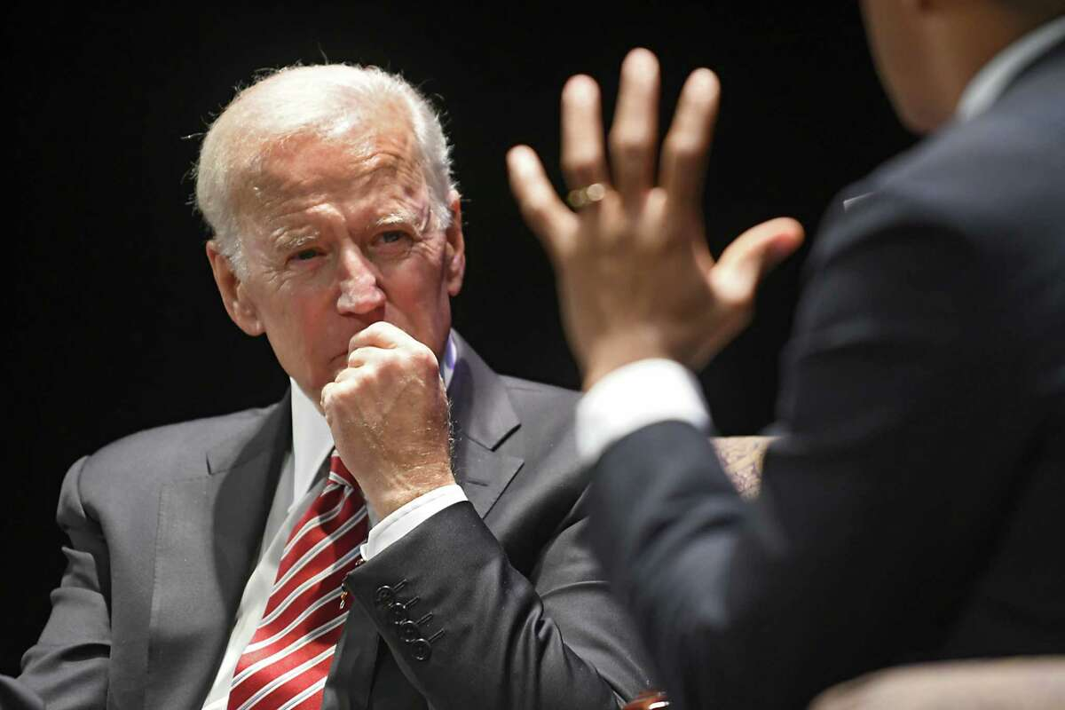 Former Vice President Joe Biden, left, speaks with Pulitzer Prize-winning journalist Jonathan Capehart on the stage at Proctors during his American Promise Tour on Monday, Nov. 20, 2017 in Schenectady, N.Y. Tickets to this event included a copy of Biden's memoir,