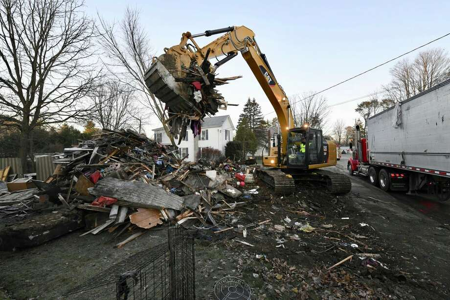 Wreckage is all that remains at the 418 Main St., home where a mother and her daughter died Monday morning. Tanya Slimmer, 39, died trying to save her daughter, Briaunna Slimmer, 15, officials said. Photo: Skip Dickstein / Times Union