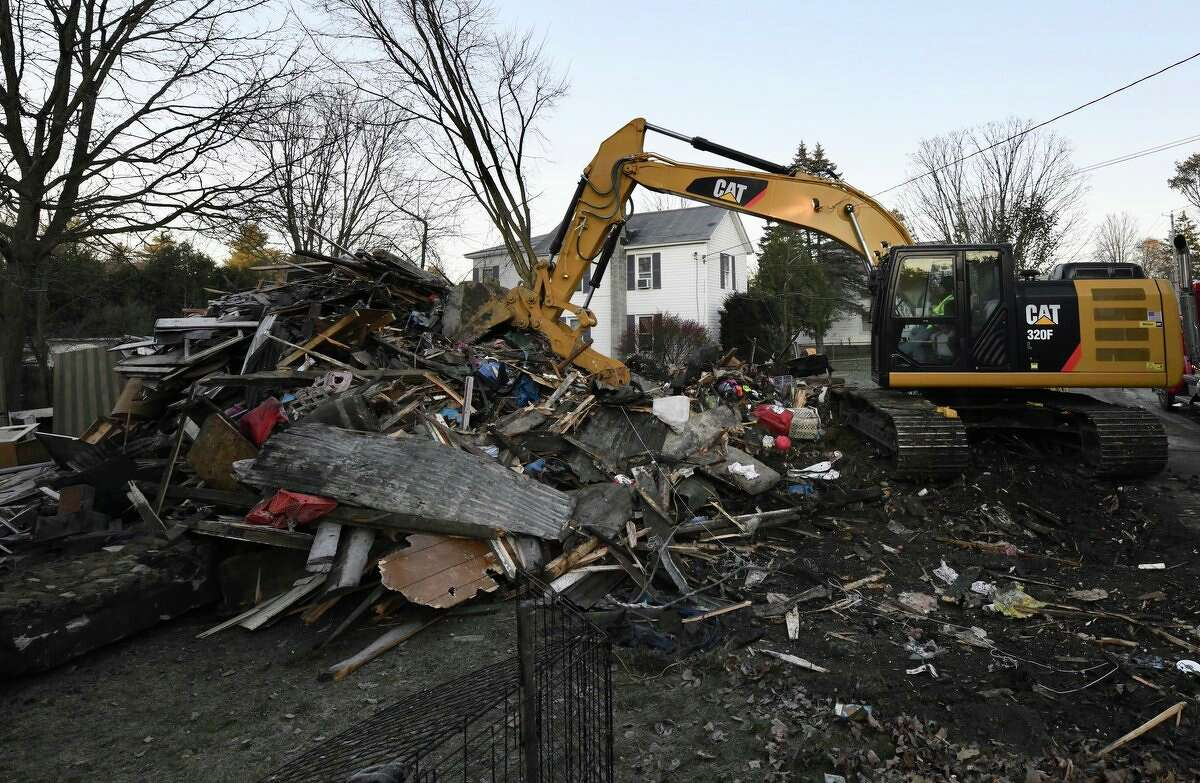Wreckage is all that remains at the 418 Main St., home where a mother and her daughter died Monday morning. Tanya Slimmer, 39, died trying to save her daughter, Briaunna Slimmer, 15, officials said.