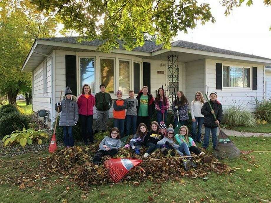 Students from Christ the King School in Sebewaing recently spent some of their spare time raking leaves for members of the community. (Submitted Photo)