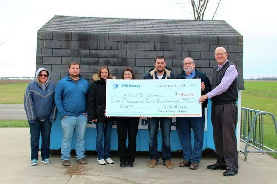 DTE Energy recently presented a $1,500 check to Eccles School for its STEM Program. Pictured are staff from the Eccles School and the Huron Intermediate School District with representatives from DTE Energy's Huron Renewable Energy Center in Bad Axe. (Submitted Photo)