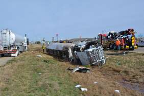 The remains of an overturned truck tractor semi-trailer carrying diesel fuel that crashed on I-27 Monday morning is shown here.
