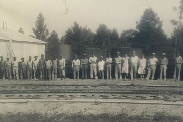 The first workers at the Conroe Creosoting Company. The company was founded by Hugh Montgomery Hawthorne VII in 1946. It operated in Conroe until 1997.