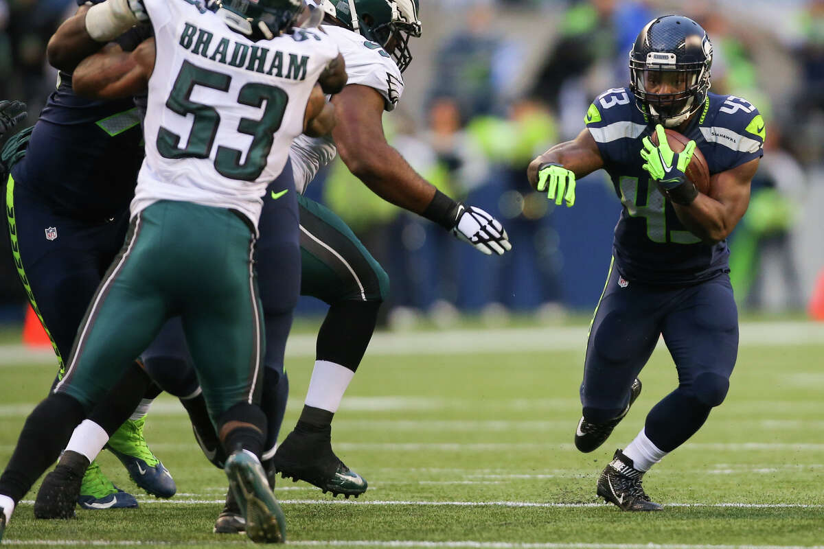 Seahawks running back Troymaine Pope runs the ball in the second half against the Eagles at CenturyLink Field on Sunday, Nov. 20, 2016.
