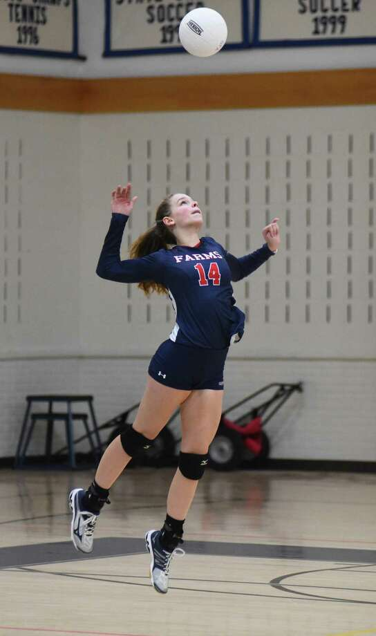 GFA's Elena Mota, a resident of Westport, makes a high-flying serve during her team's New England Class C quarterfinal win last week at Coyle Gym in Westport. Photo: Contributed Photo