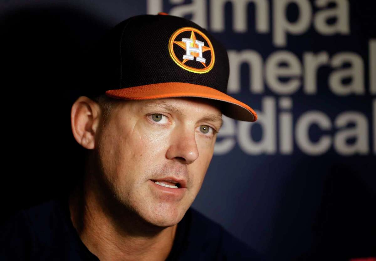 Houston Astros manager A.J. Hinch speaks to the media before a baseball game against the Texas Rangers Wednesday, Aug. 30, 2017, in St. Petersburg, Fla. The Astros moved their three-game home series against the Rangers to St. Petersburg after being displaced by Hurricane Harvey. Hinch announced the team would be returning to Houston after Thursday's game in St. Petersburg. (AP Photo/Chris O'Meara)
