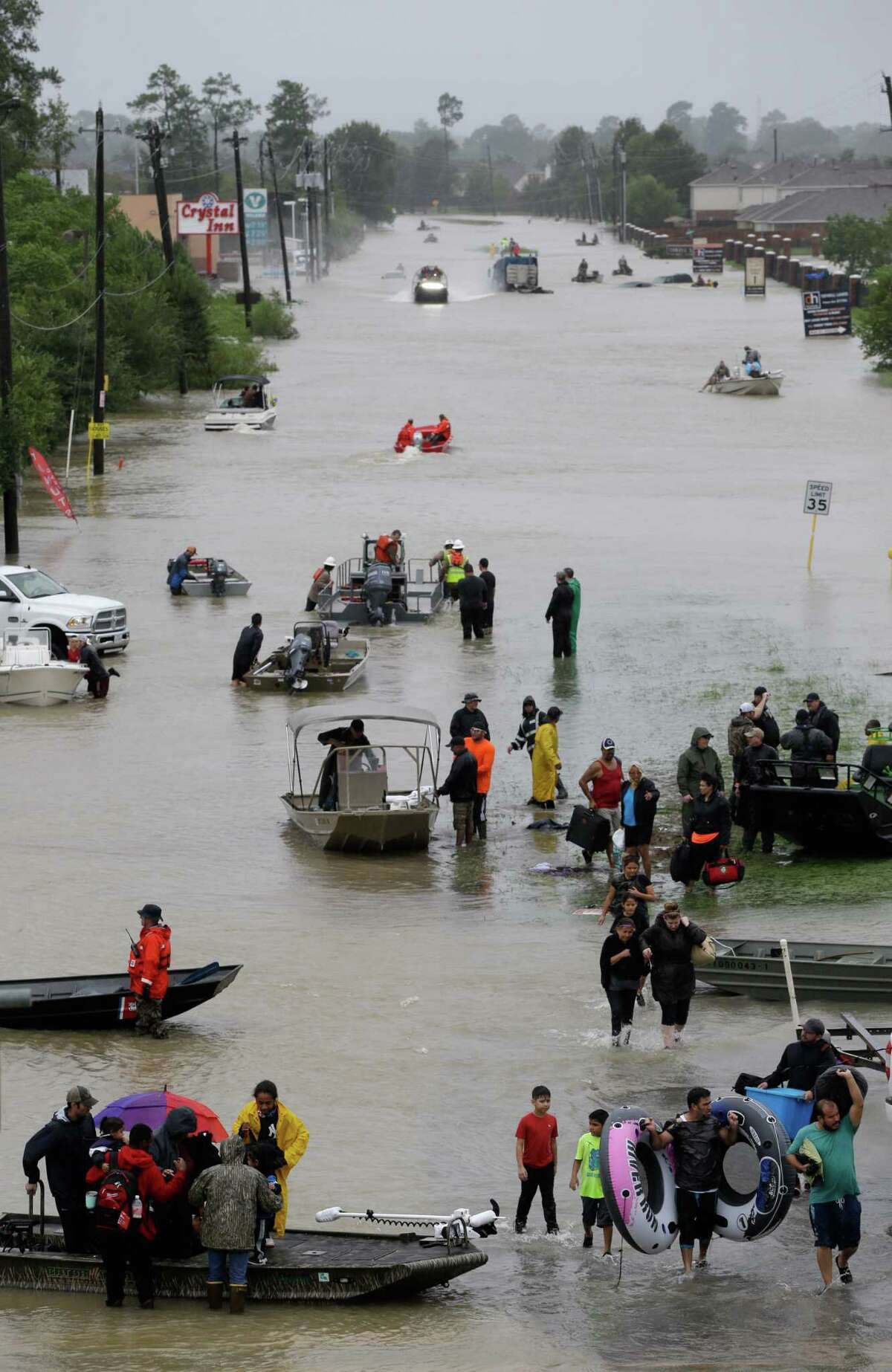 Rescue boats work along Tidwell at the east Sam Houston Tollway helping to evacuate people Monday, August 28, 2017. Much of the area is flooded from rains after Hurricane Harvey. ( Melissa Phillip / Houston Chronicle)