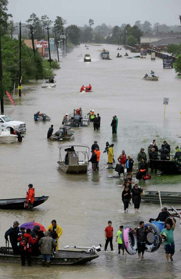 Rescue boats work along Tidwell at the east Sam Houston Tollway helping to evacuate people Monday, August 28, 2017. Much of the area is flooded from rains after Hurricane Harvey. ( Melissa Phillip / Houston Chronicle) Photo: Melissa Phillip, Staff / Houston Chronicle 2017