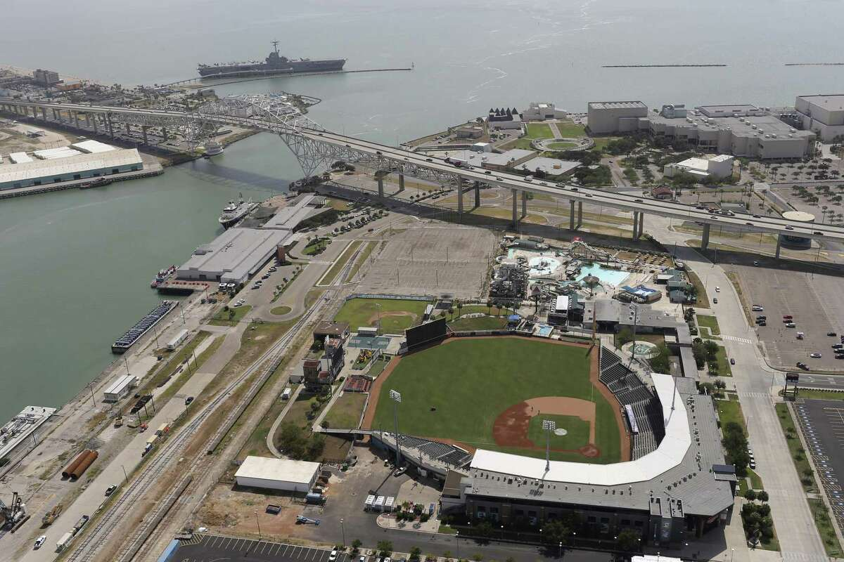 The grass of Whataburger Field and the Port of Corpus Christi are seen Tuesday, Aug. 8, 2017. Oil production in the Eagle Ford Shale just north of Corpus Christi has helped turned that port into the nation's top crude oil exporter.