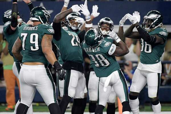 Philadelphia Eagles running back Kenjon Barner (38) and his team celebrate his first quarter touchdown against the Dallas Cowboys on Sunday, Nov. 19, 2017 at AT&T Stadium in Arlington, Texas.