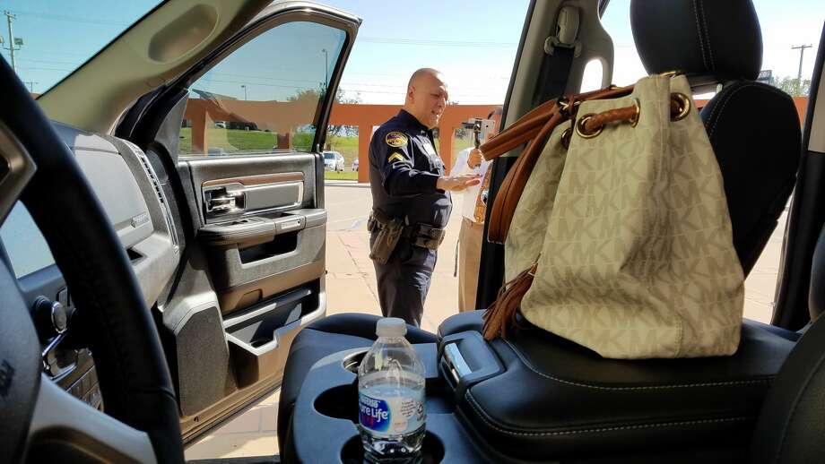 The Laredo Police Department put out a display with a black Dodge Ram loaded with valuables to simulate what auto-theft investigators are seeing frequently in their cases. Photo: Laredo Morning Times