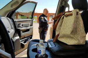 The Laredo Police Department put out a display with a black Dodge Ram loaded with valuables to simulate what auto-theft investigators are seeing frequently in their cases.