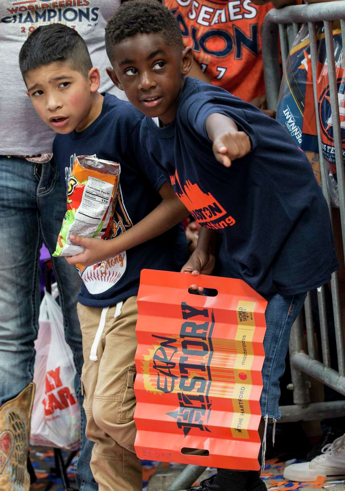 Houston Astros fans Mario Murillo, left, and John Stewart look up the street as they wait for the Astros World Series championship celebration parade on Friday, Nov. 3, 2017, in Houston. ( Brett Coomer / Houston Chronicle )
