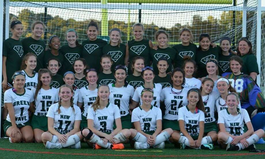 The New Milford Varsity Field Hockey team showed support for the freshman squad this season, wearing their Z shirtsto honor Coach Fran Zaloski. The freshmen played the game. Upperclassmen were ball girls, coaches, announcers, etc. Photo: Contributed Photo /
