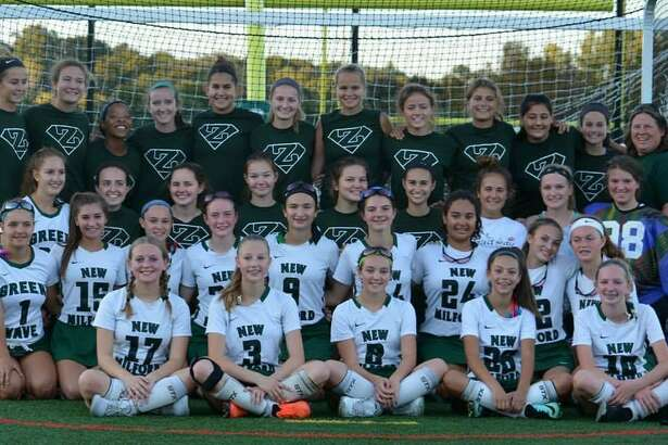 The New Milford Varsity Field Hockey team showed support for the freshman squad this season, wearing their Z shirtsto honor Coach Fran Zaloski. The freshmen played the game. Upperclassmen were ball girls, coaches, announcers etc.