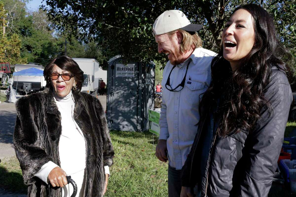 Doris Davis talks with Chip and Joanna Gaines outside of her Hurricane Harvey flooded home in Houston. The Gaines brought their HGTV show