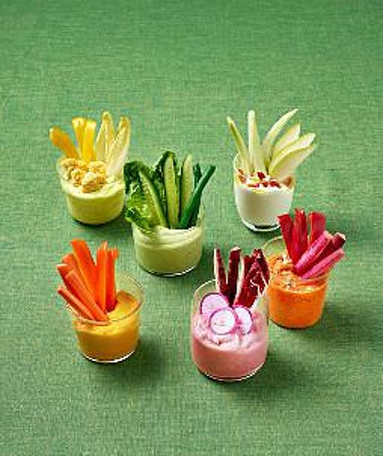 Veggie Shooters are individual hors d'oeuvres that take the place of the typical crudité platter. Photo: Levi Brown / Contributed Photo