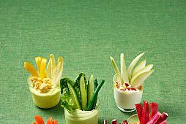 Veggie Shooters are individual hors d'oeuvres that take the place of the typical crudité platter.
