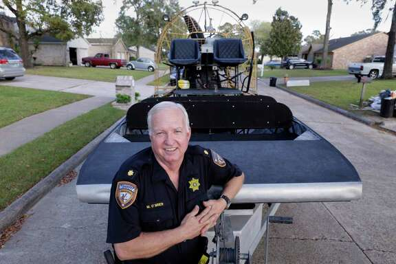 Harris Co. Sheriff  Marty O'Brien Nov. 6th, 2017, with the airboat he and Dep. Richard Jue used in the Parkway Forest subdivision neighborhood at Fern Forest and Deep Valley, one of several subdivisions in the area around Tidwell and Beltway 8 where they used the boat to rescue 100s of people from their flooded homes during hurricane Harvey flooding in Houston, TX. (Michael Wyke / For the  Chronicle)