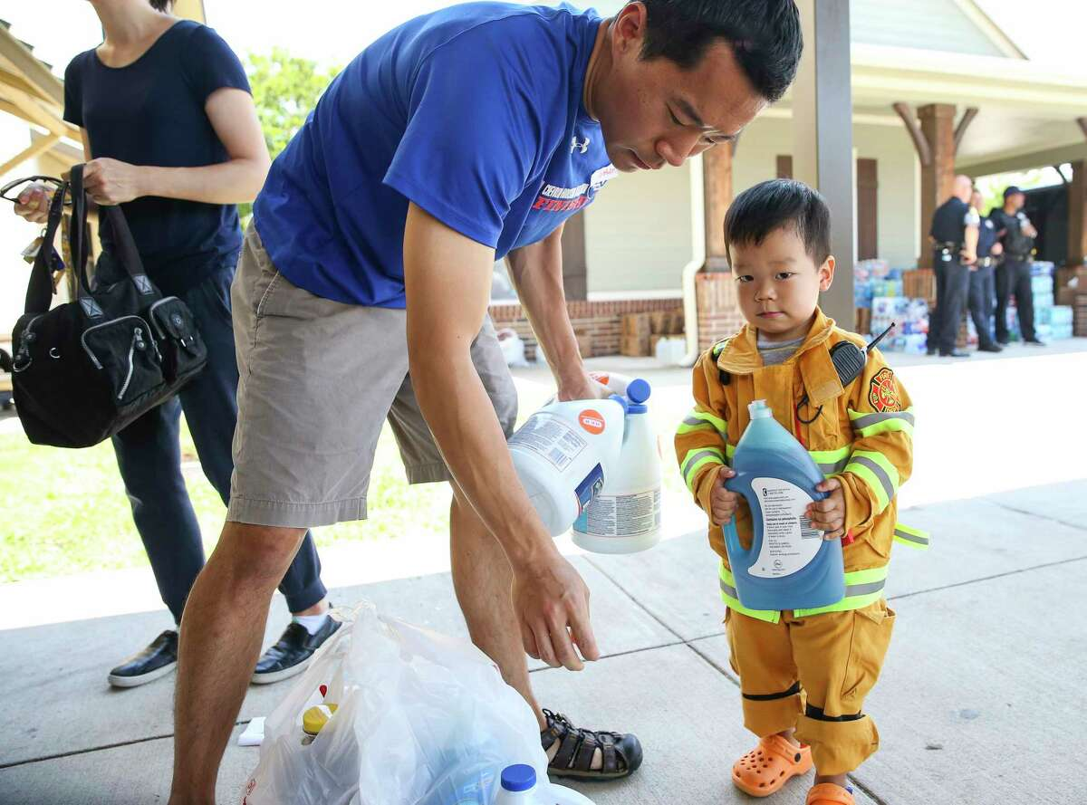Gideon Kim, 2, insisted on helping his father, Nathan, carry donated materials as they volunteered at The Forge for Families, which sheltered Harvey evacuees.Gideon Kim, 2, insisted on helping his father, Nathan, carry donated materials as they volunteered at The Forge for Families, which sheltered Harvey evacuees.