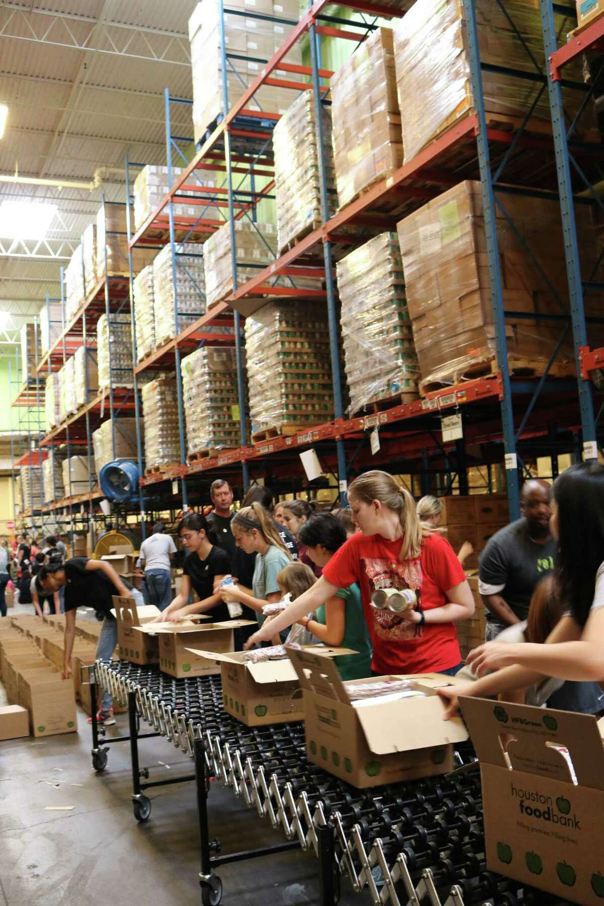 Immediately after Hurricane Harvey the Houston Food Bank saw an increase in volunteers. They were put to work sorting and packing food and other supplies for relief efforts.