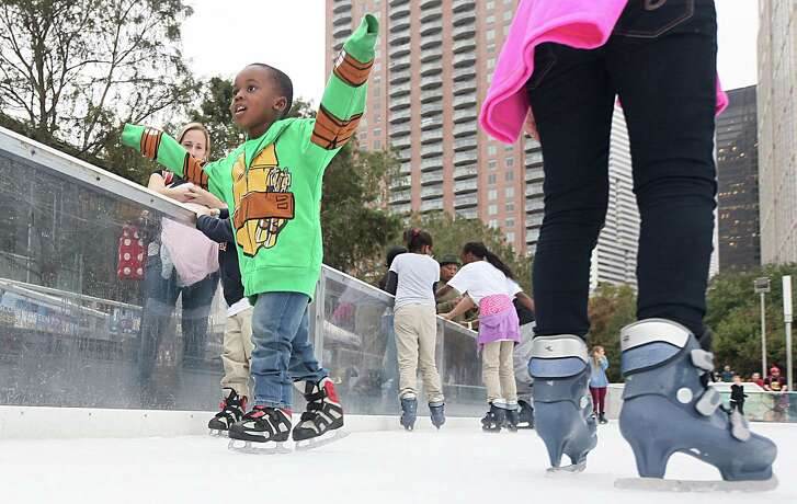 Riley Doyle finds his balance during an ice-skating party for 60 children from the Sunnyside neighborhood.  Riley Doyle finds his balance during an ice-skating party for 60 children from the Sunnyside neighborhood.