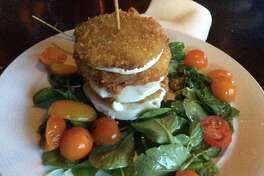 Sunset Terrace at the Grove Park Inn is the iconic spot for dinner in Asheville. The Terrace Tomato and Mozzarella; perfectly fried green tomatoes sandwiching fresh mozzarella and served with arugula, cherry tomatoes and lemon grass vinaigrette is the perfect starter to  memorable dinner.