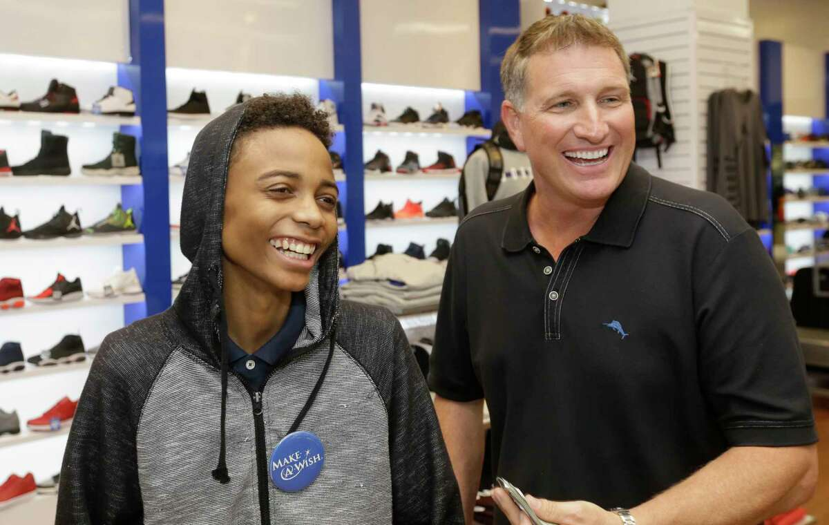 Adolph Taylor, left, shops with Make-A-Wish volunteer Erik Johnson at the Galleria. Adolph Taylor, left, shops with Make-A-Wish volunteer Erik Johnson at the Galleria.