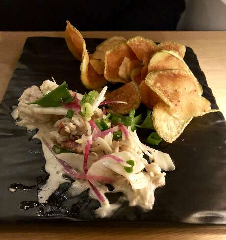 Crab remoulade with pink peppercorn potato chips at Salt Wood Kitchen. Photo: Michael Bauer, The Chronicle