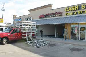A storefront was destroyed after a car landed in it as a result of a wreck on Monday, Nov. 20, 2017.