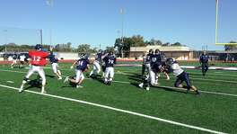 Boerne Champion's offensive line creates a hole for running back Nick De Los Santos Monday during practice in Boerne.