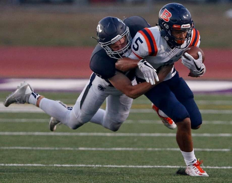 Brandeis' Jalen Griffin tries to shake the tackle of Boerne Champion's Justin Allen a Sept. 14, 2017 game at Boerne ISD Stadium. Photo: Edward A. Ornelas /Express-News
