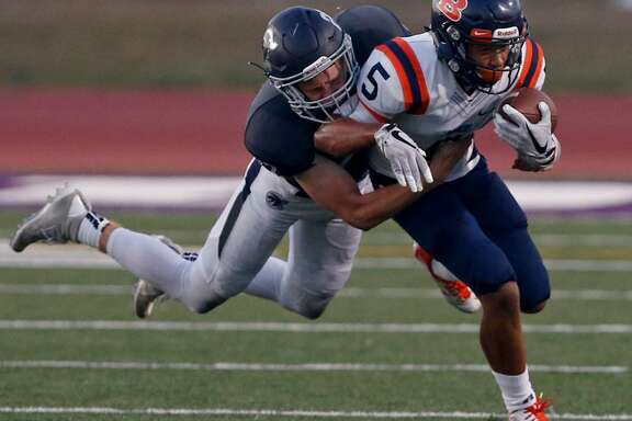 Brandeis' Jalen Griffin tries to shake the tackle of Boerne Champion's Justin Allen a Sept. 14, 2017 game at Boerne ISD Stadium.