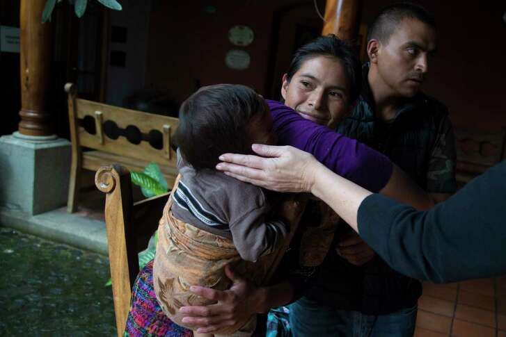 Linda McCarty extends her hand to caress Victor Hernandez Sica while his mother Juana Sica Juarez holds him at the Casa de Fe, where the family is staying while Victor receives care at the hospital. Thursday, Oct. 5, 2017, in Antigua. ( Marie D. De Jesus / Houston Chronicle )