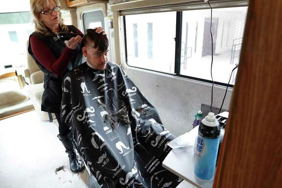 Barbara Goodson cuts Lawrence Campbell's hair in her mobile salon.    Barbara Goodson cuts Lawrence Campbell's hair in her mobile salon.