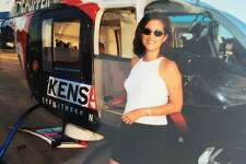 Sarah Lucero through the years: An early shot of the seasoned anchorwoman, next to another celebrity, KENS-TV's news helicopter, Chopper 5.